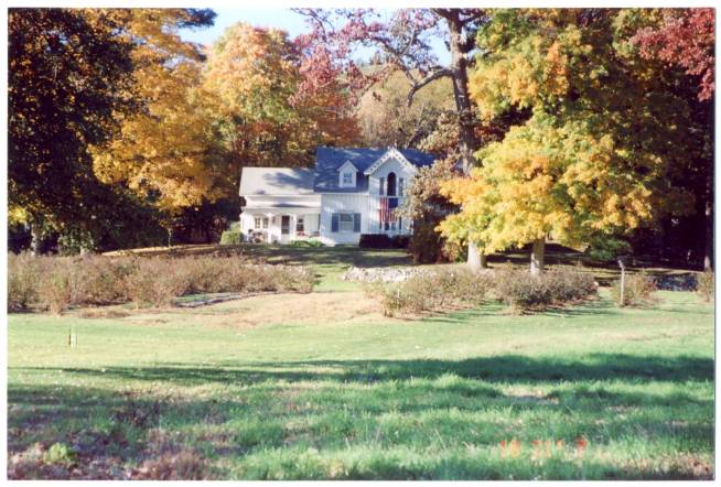 The farm house amid the white oaks.